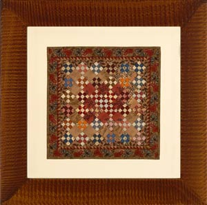Miniatue quilt in tiger frame